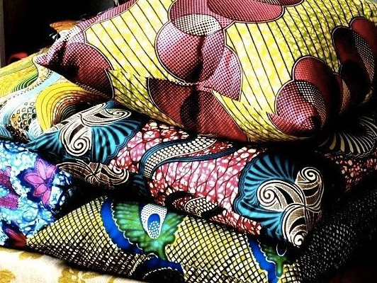 Rustic interior design - yellow toned tribal printed cushions