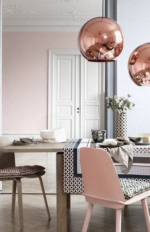 Rose gold and pink dining room with patterns