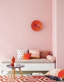Pink, orange and red living space with pink wall