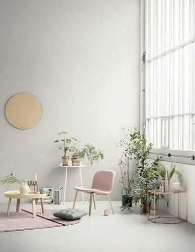 Blush pink furnishings in large white warehouse