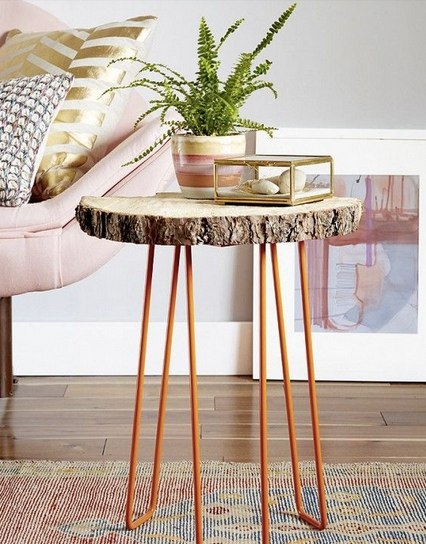 Wood trunk coffee table with orange legs and pink sofa