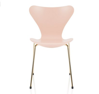 Modern pink chair with rose gold curved legs
