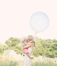 mother and daughter with balloon