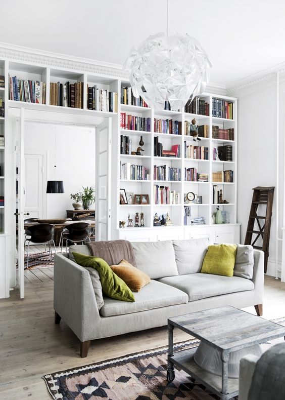 white bookshelf wall in living room