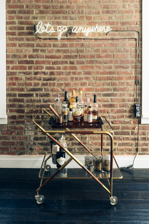 neon light above bar cart