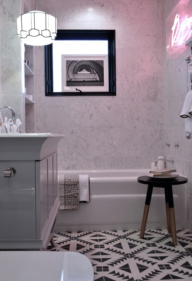 black and white bathroom with pink neon light