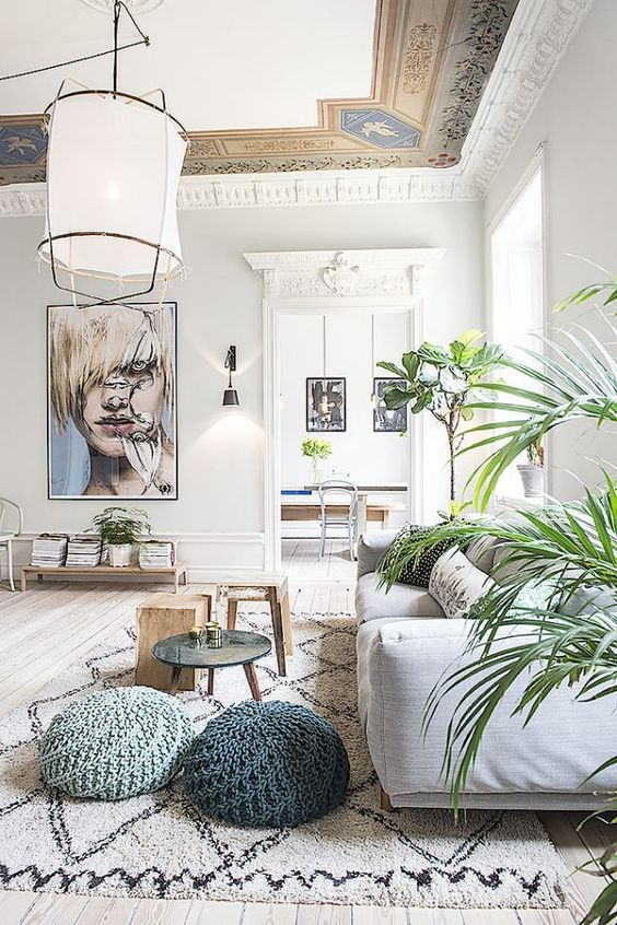 living room with greenery and artwork