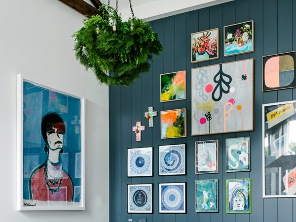 eclectic blue wall gallery wall