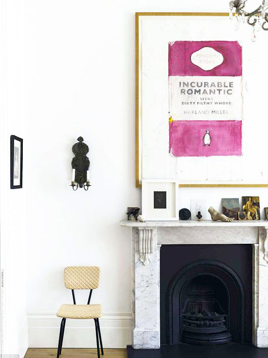 penguin books print artwork above fireplace