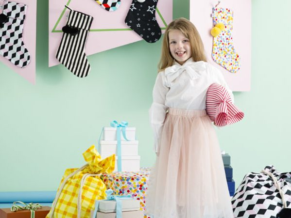 Home interior styles - little girl with Santa stockings