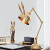 Office Interior Design - gold bunny ears table lamp