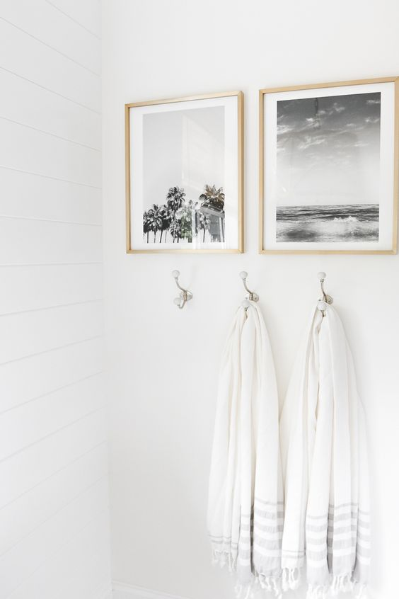 Small bathroom ideas - artwork and hooks with white towels