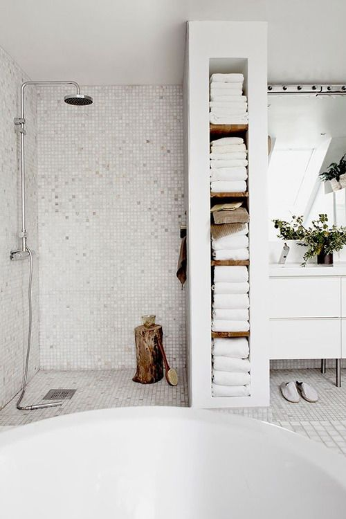 Small bathroom ideas - long vertical shelving