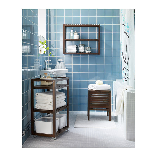 Small bathroom ideas - brown bathroom caddy with blue wall