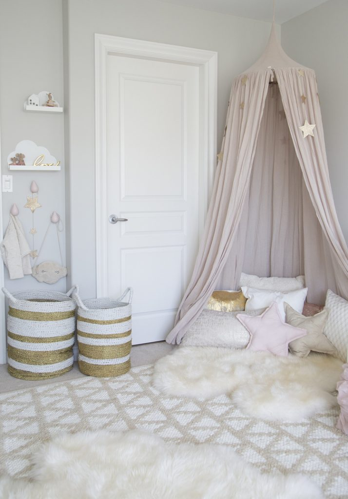 Small bedroom decorating ideas - pink canopy and fuzzy rug