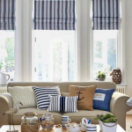 nautical living room couch and striped blinds