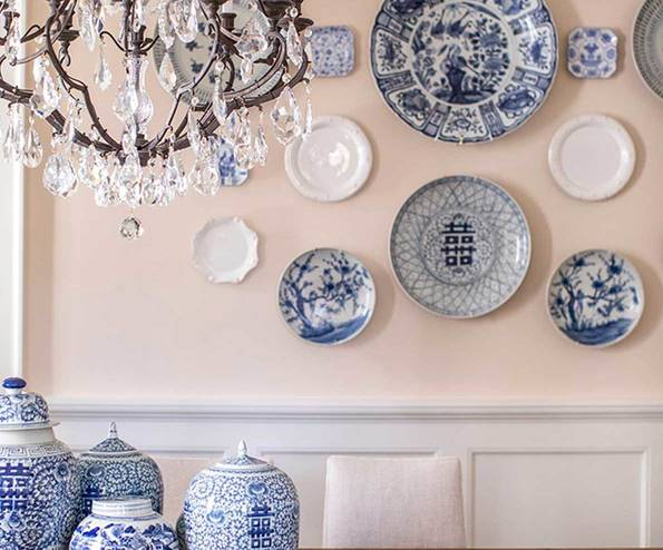 French accent plate gallery wall with chandelier