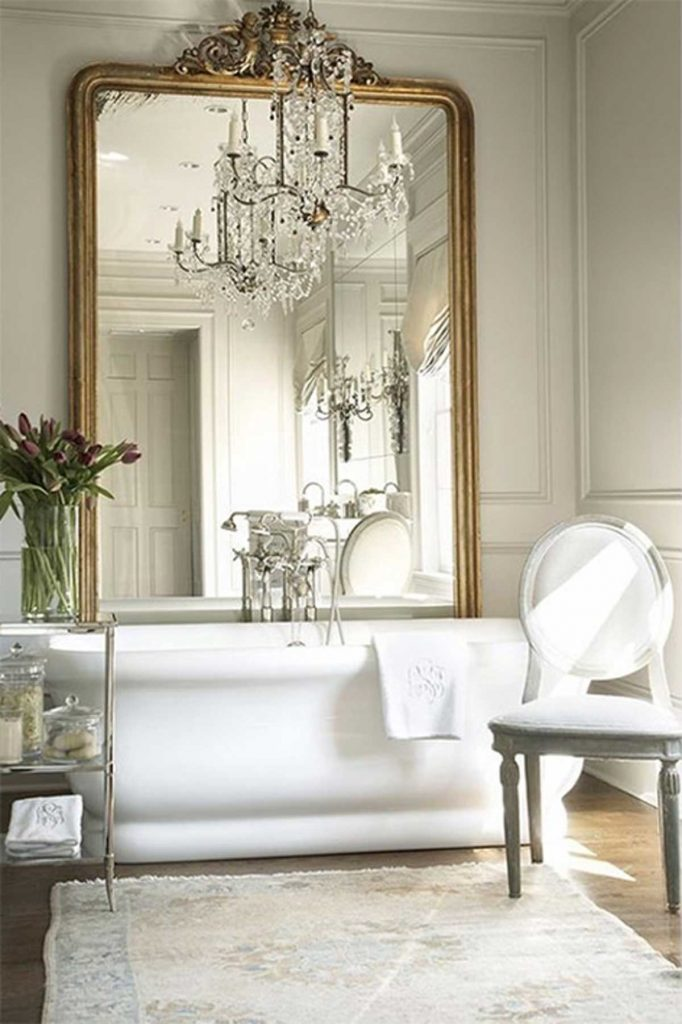French accent style gold mirror in bathroom