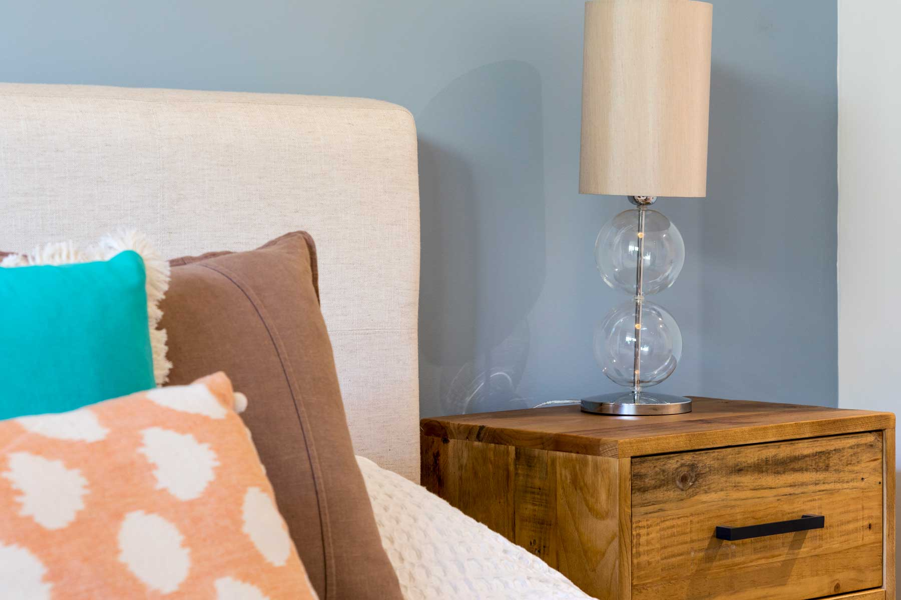 Robyn's vibrant beach apartment - after - bedside 2