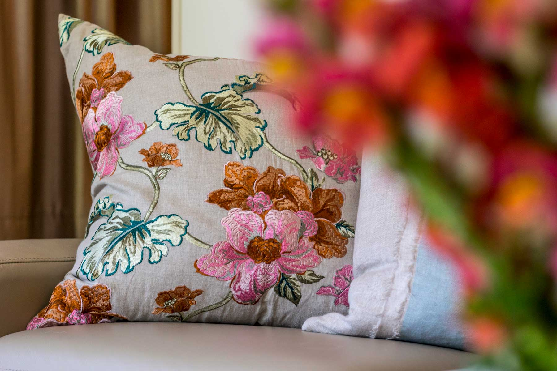 Robyn's vibrant beach apartment - after - cushion floral