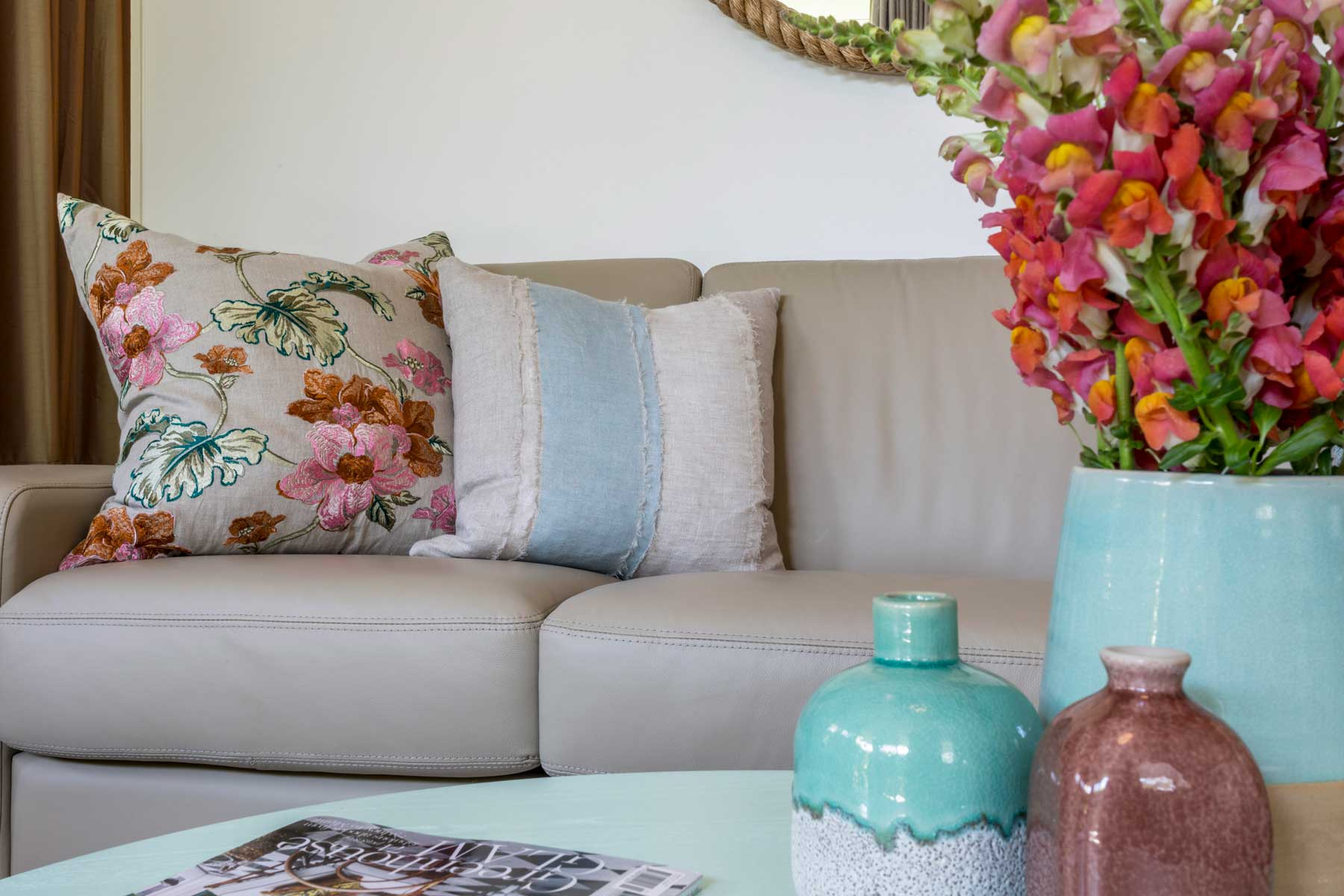 Robyn's vibrant beach apartment - after - cushion vases