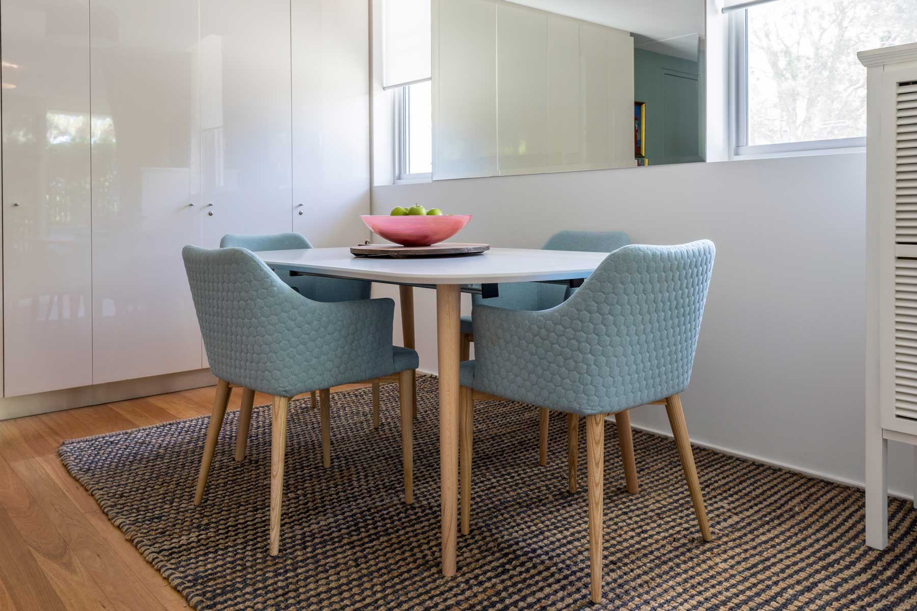 Robyn's vibrant beach apartment - after - dining table
