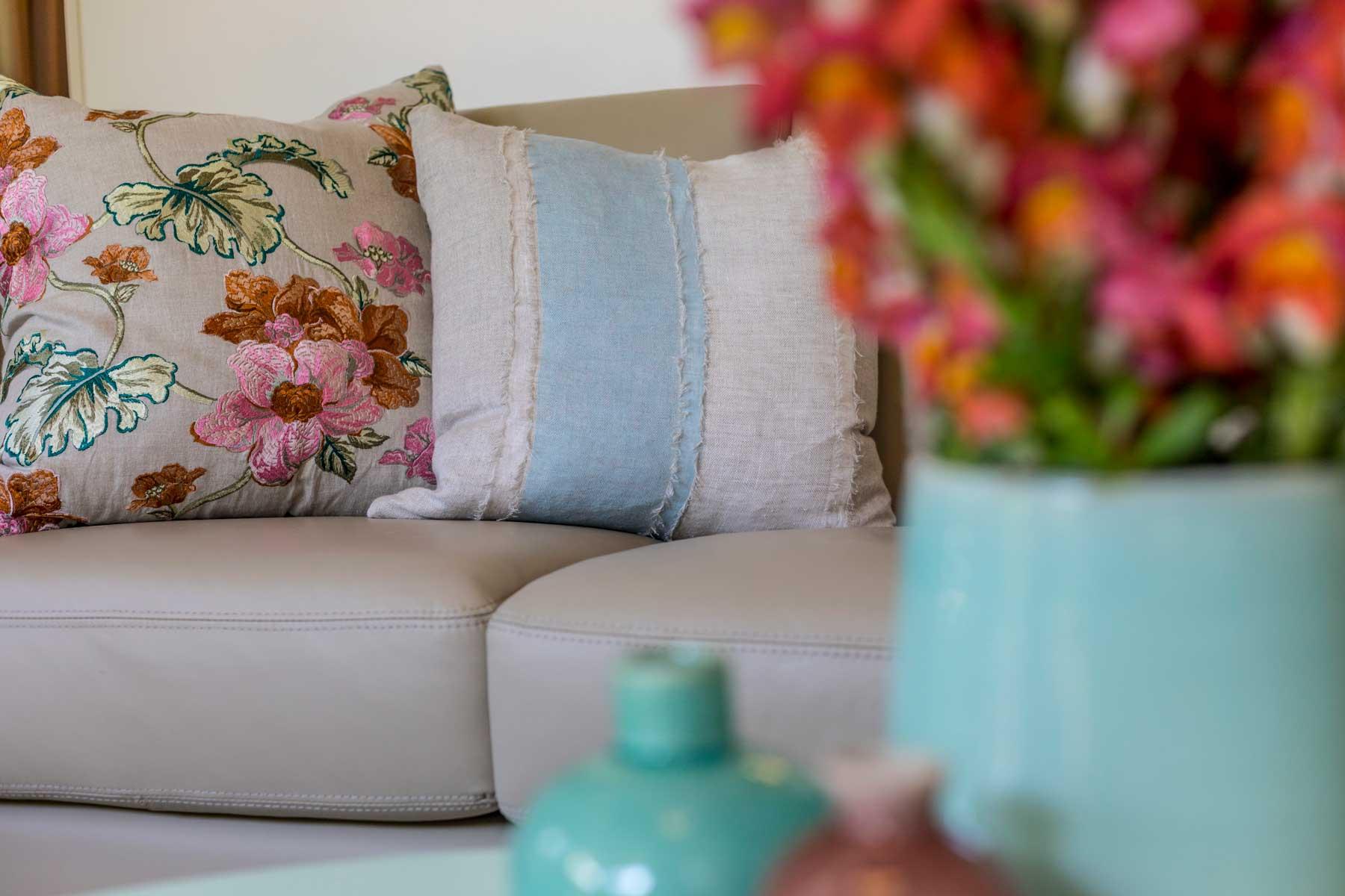 Robyn's vibrant beach apartment - after - floral cushions