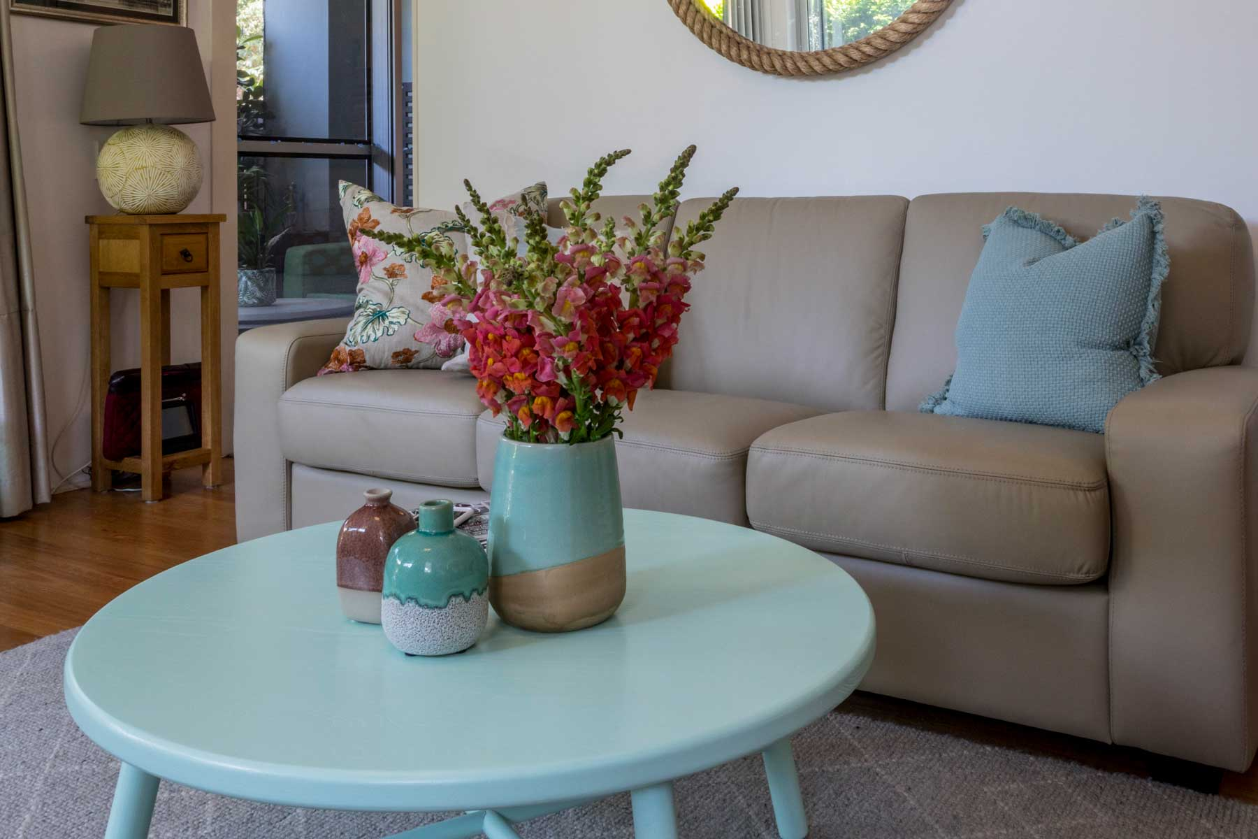 Robyn's vibrant beach apartment - after - lounge floral 2