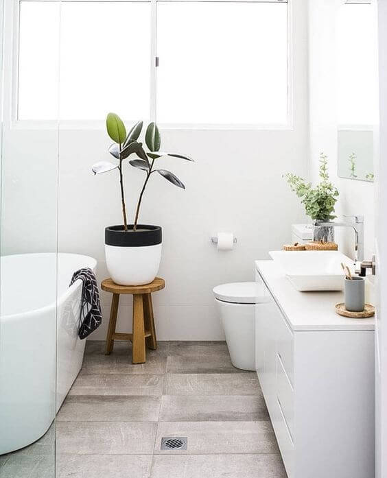 Scandi interior design bathroom with greenery