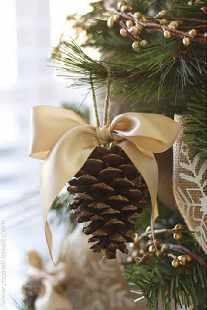 Christmas tree decorating pine cone ornament
