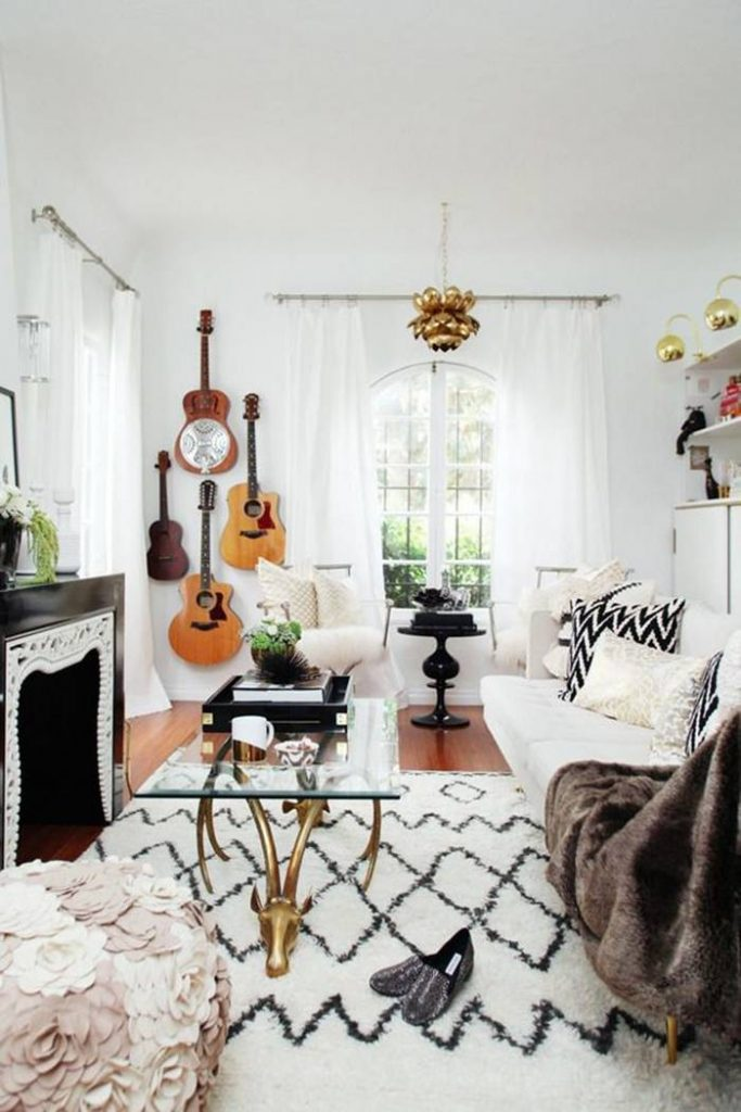 boho living room with guitar wall