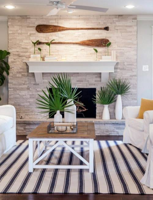 coastal style living room with oars wall hanging