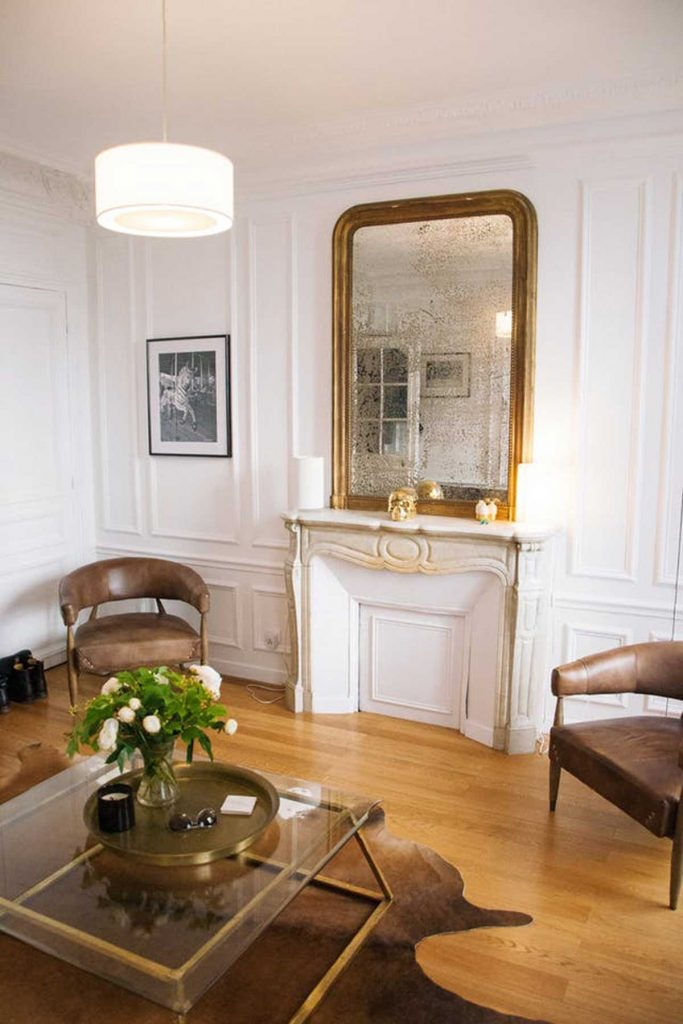 French accent style gold mirror above fireplace