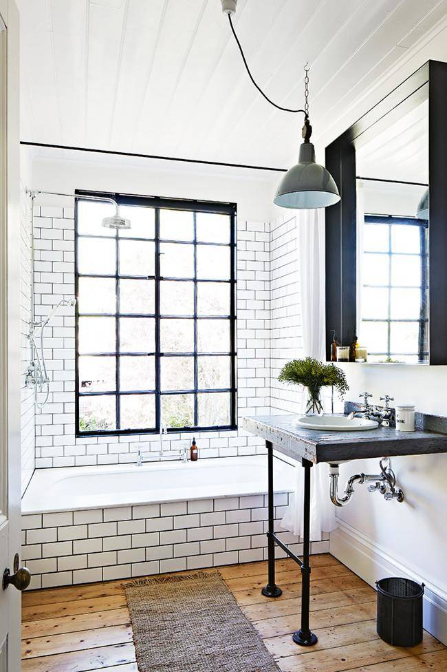 industrial bathroom white and black with wooden floor