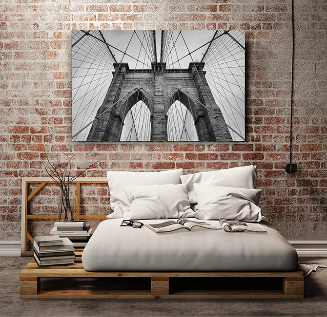 industrial bedroom with bridge artwork